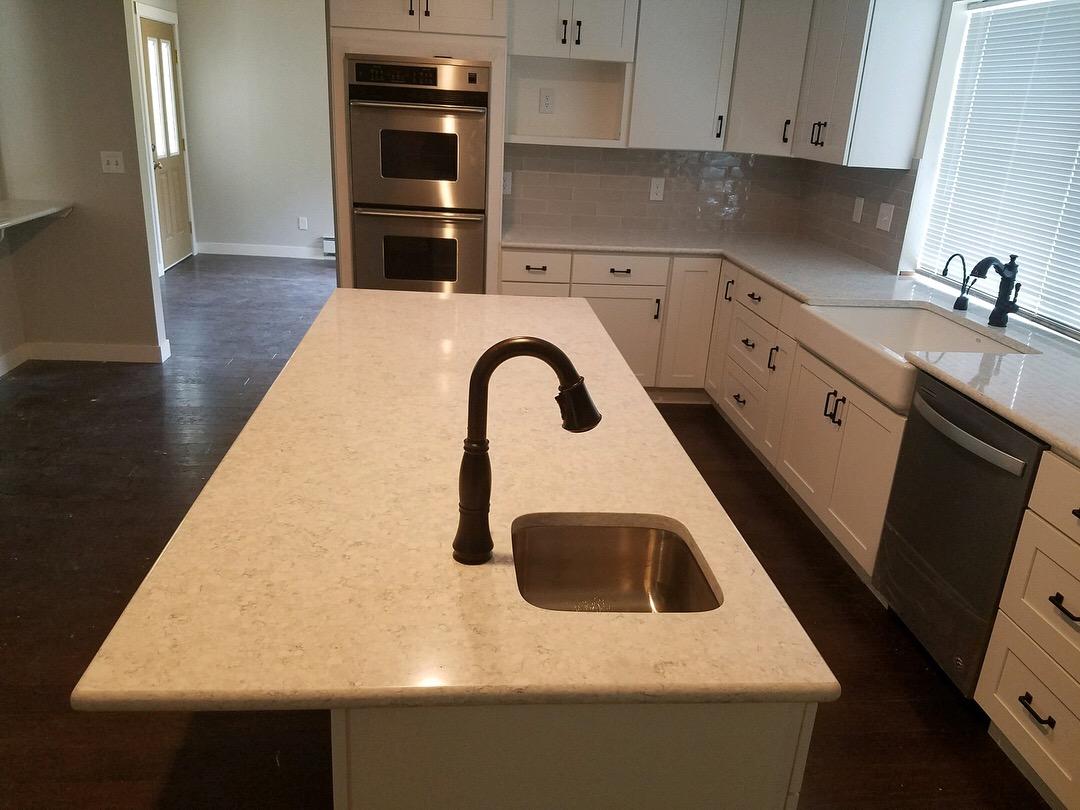 Kitchen having White Granite Countertop
